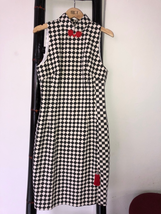 01fa32ee9 The checkered dresses come with interesting tassel embellishment at the  front slit. Otherwise, opt for the embroidered floral buttons instead.